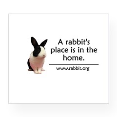 A rabbits place is in the hom Oval Wine Label